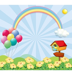 A garden near the hills with balloons a rainbow vector