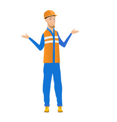 Confused young caucasian builder with spread arms vector