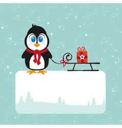 Christmas pinguin with gift vector