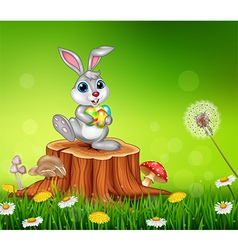 Happy little bunny holding easter eggs vector