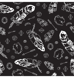 Seamless pattern with feathers and beads on black vector