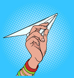 hand launches paper airplane pop art vector image