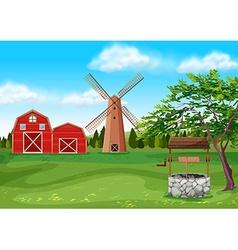 Barns and windmill in the farmyard vector