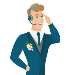 Young caucasian groom in headset vector