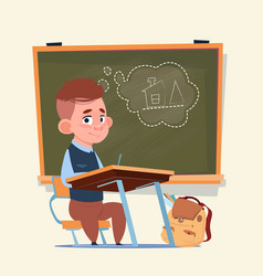 Small school boy sit at desk over class board vector