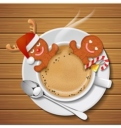 Two gingerbread cookie mans in cup of hot coffee vector