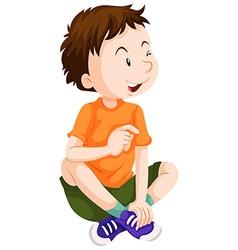 Boy in orange shirt sitting vector