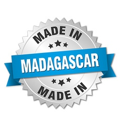 Made in madagascar silver badge with blue ribbon vector