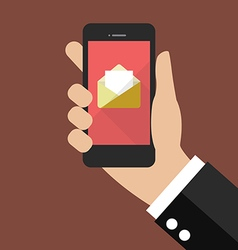 Hand holding smartphone with email icon vector image
