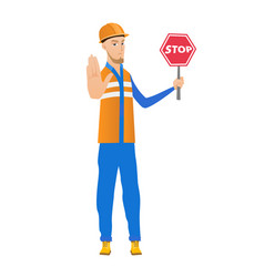young caucasian builder holding stop road sign vector image vector image