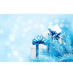 Holiday blue background with gift boxes and tree vector image