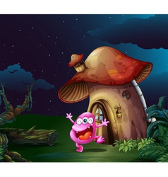 A pink monster near the mushroom house vector