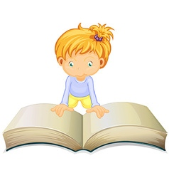 Little girl reading from big book vector