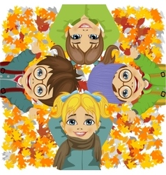 Happy kids lying on colorful autumn leaves in park vector