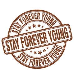 Stay forever young brown grunge round vintage vector