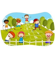 Children playing hopscotch in the park vector image vector image
