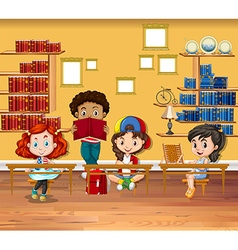 Children reading books in the classroom vector