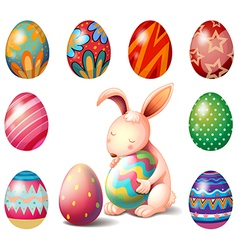 A bunny surrounded with easter eggs vector
