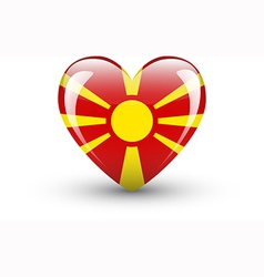 Heart-shaped icon with flag of macedonia vector