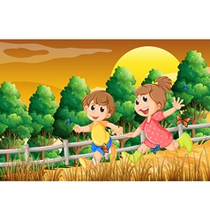 Kids playing at the forest near the wooden fence vector image vector image