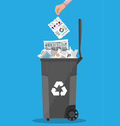 Trash recycle bin container full of paper vector