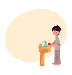 boy in pajamas washing hands with soap under vector image