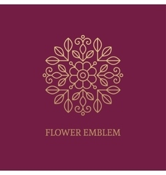 Golden floral emblem vector