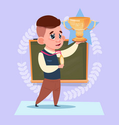 small school boy hold winner cup standing over vector image vector image