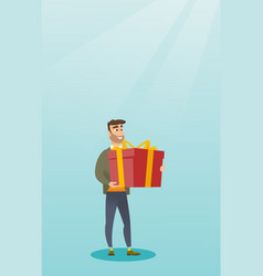 Young caucasian man holding box with gift vector