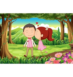 A sweet and loving couple at the forest vector image