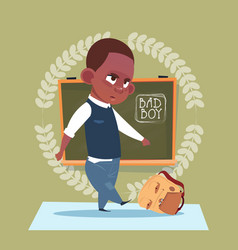 Small bad school boy standing over class board vector