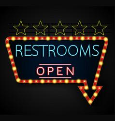 Shining retro light banner restrooms on a black vector