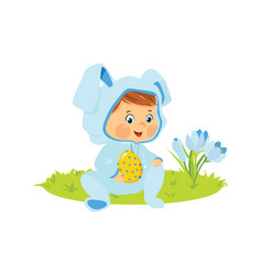 Baby boy in bunny costume with decorative egg vector