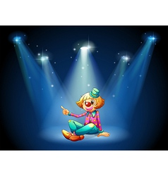 A stage with a female clown sitting at the center vector