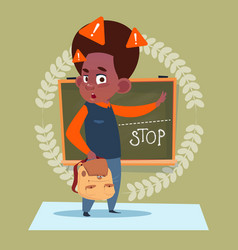 Small school boy standing over class board with vector