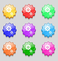 Gears icon sign symbol on nine wavy colourful vector