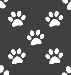 paw icon sign Seamless pattern on a gray vector image