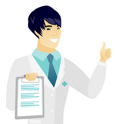 Young asian doctor with clipboard giving thumb up vector