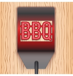 Barbecue hot metal spatula on wooden background vector image