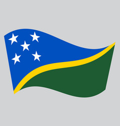 Flag of solomon islands waving on gray background vector