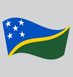 flag of solomon islands waving on gray background vector image vector image