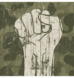 fist on camouflage vector image