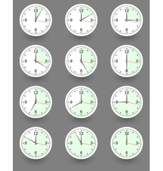 Twelve clocks showing different time vector