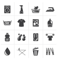 Black washing machine and laundry icons vector