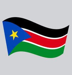 Flag of south sudan waving on gray background vector