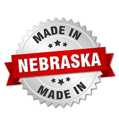 Made in nebraska silver badge with red ribbon vector