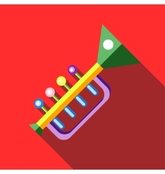Children s toy musical trumpet on red background vector image