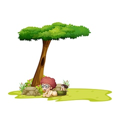 A boy playing under the tree vector image vector image