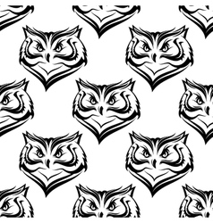 Seamless pattern of the head of a fierce owl vector image vector image