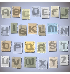 Ink alphabet on pieces of old paper vector